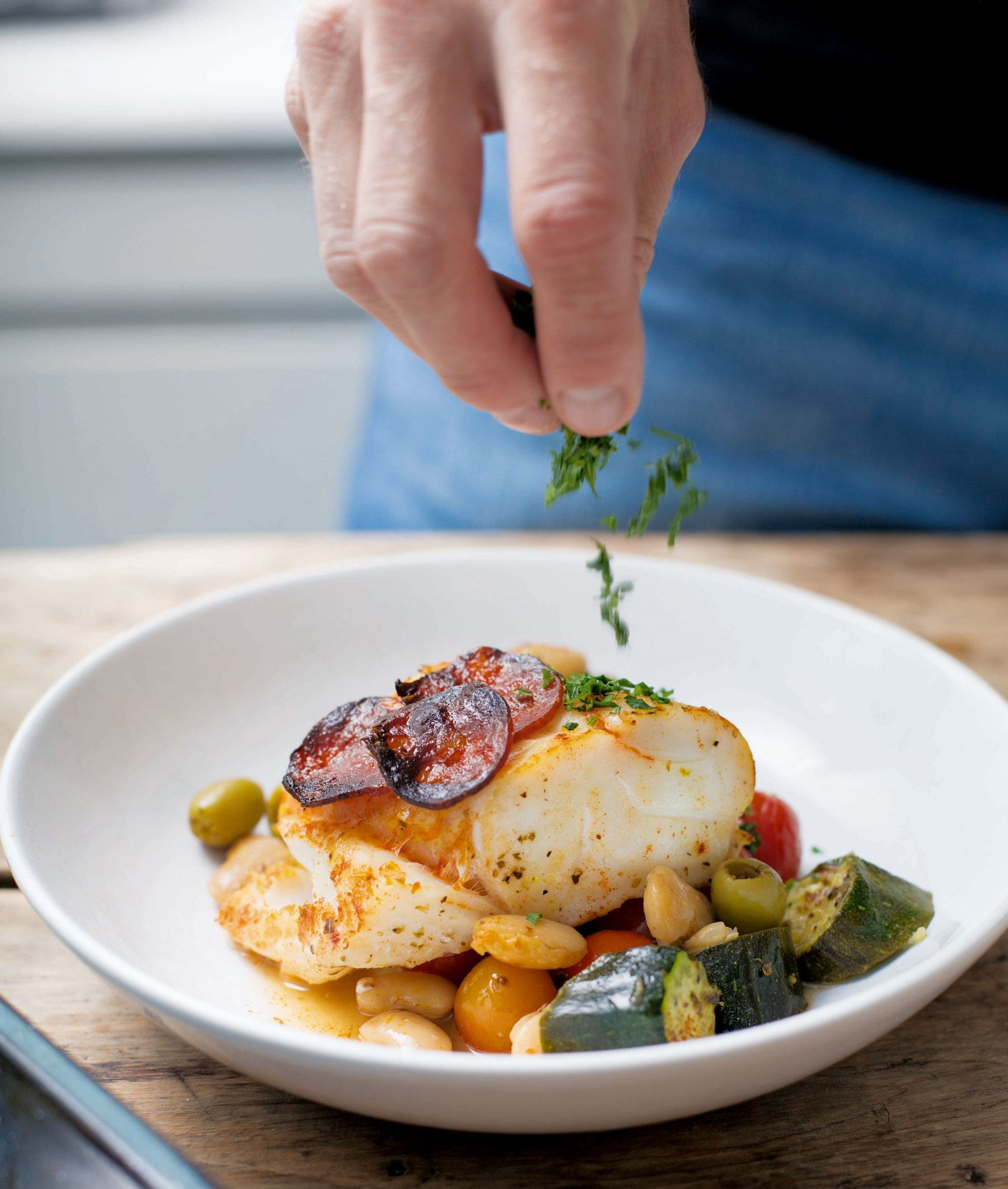 Baked cod with beans, courgettes and chorizo