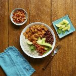 Brazilian-style pork with avocado and black beans